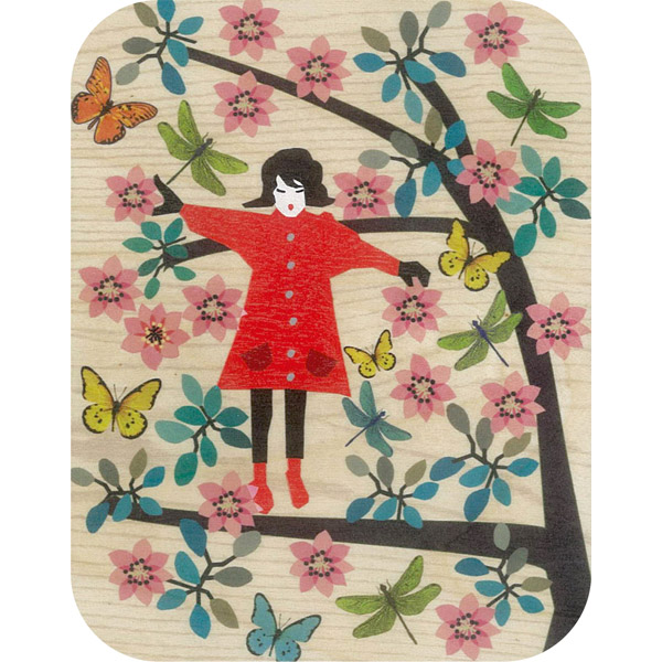 Wooden card girl balancing in tree